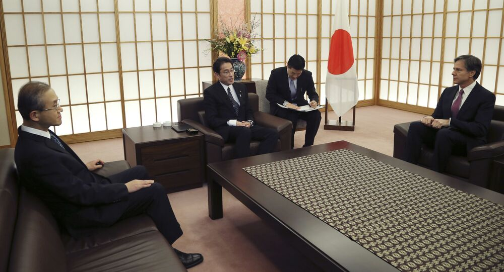 Japanese Foreign Minister Fumio Kishida, center left, speaks with South Korean First Vice Foreign Minister Lim Sung-nam, left, and U.S .Deputy Secretary of State, Antony Blinken, right, at the Foreign Ministry in Tokyo, Friday, Jan. 15, 2016.