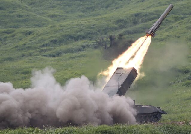Ground Self-Defense Force anti-land mine missile is launched during an annual live firing exercise