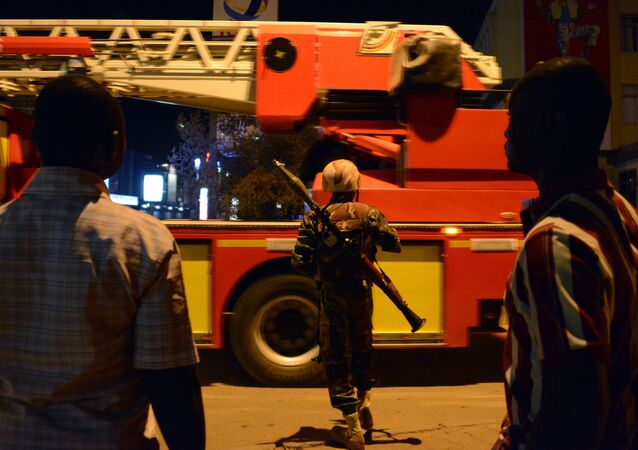 Burkina Faso's soldier stands near Hotel Splendid where the attackers remain with sporadic gunfire continuing in Burkina Faso's capital Ouagadougou on January 15, 2016.