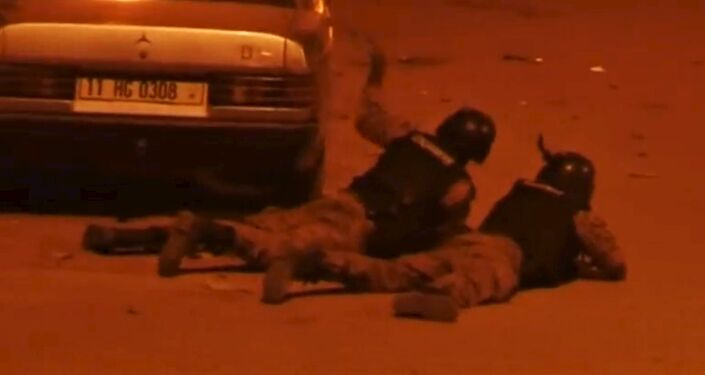 Security officers take their positions outside Splendid Hotel in Ouagadougou