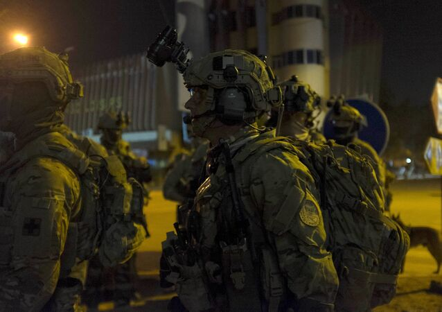 French and U.S. soldiers gather before launching a counter-assault on Islamist gunmen at the Splendid Hotel in Ouagadougou, Burkina Faso, January 16, 2016