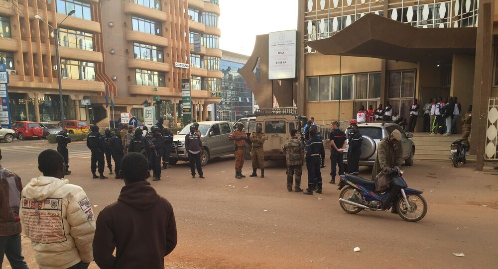 Security forces gather near the Hotel that was attacked by suspected militants in Ouagadougou, Burkina Faso, Saturday, Jan. 16, 2016