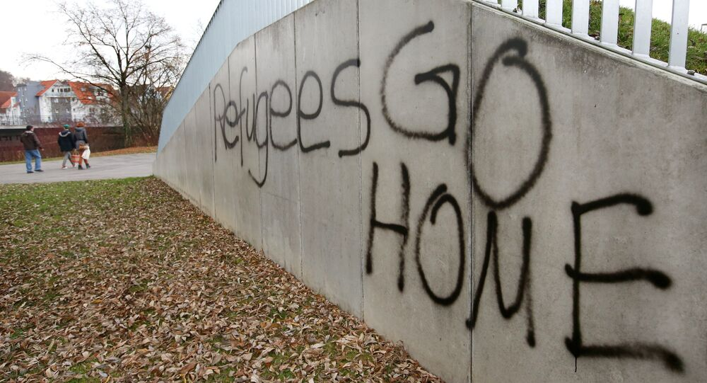 The lettering Refugees GO HOME is sprayed onto a wall in Sigmaringen, southern Germany
