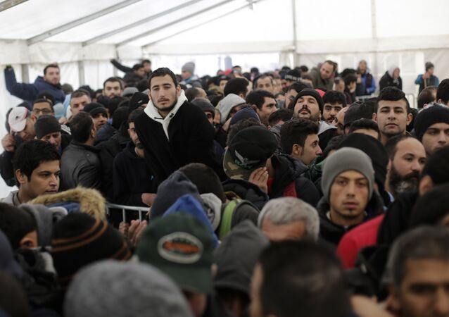 Hundreds of migrants waits in a tent to continue their registration process at the central registration center for refugees and asylum seekers LaGeSo (Landesamt fuer Gesundheit und Soziales - State Office for Health and Social Affairs) in Berlin