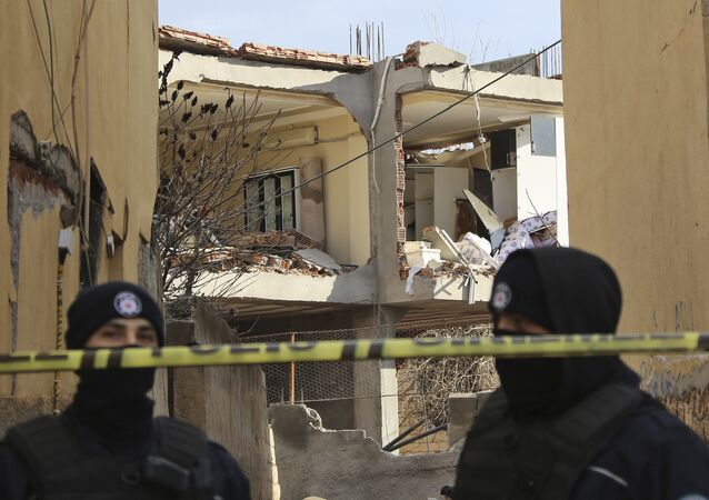 Turkish police officers secure the area around a destroyed police station in Cinar, in the mostly-Kurdish Diyarbakir province in southeastern Turkey