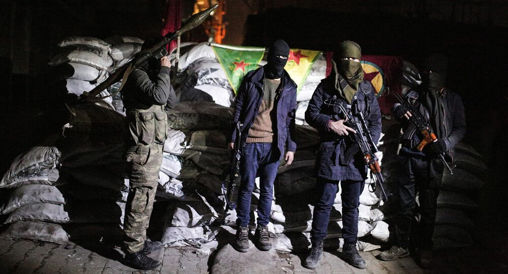 Militants of the Kurdistan Workers' Party, or PKK, stand at a barricade in Sirnak, Turkey. (File)
