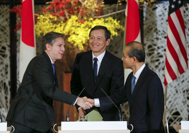 US Deputy Secretary of State Antony Blinken, left, Japanese Vice Foreign Minister Akitaka Saiki, center, and South Korean First Vice Foreign Minister Lim Sung-nam attend a joint news conference at Foreign Ministry's Iikura Guesthouse in Tokyo Saturday, Jan. 16, 2016 following their trilateral meeting.