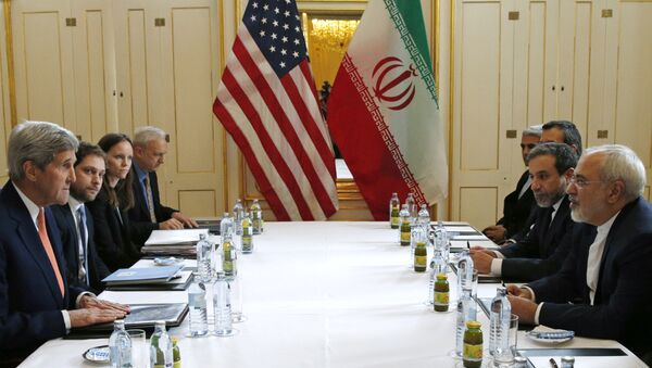 US Secretary of State John Kerry, left, meets with Iranian Foreign Minister Mohammad Javad Zarif, right, in Vienna, Austria, Saturday, Jan. 16, 2016, on what is expected to be implementation day, the day the International Atomic Energy Agency (IAEA) verifies that Iran has met all conditions under the nuclear deal. - Sputnik International