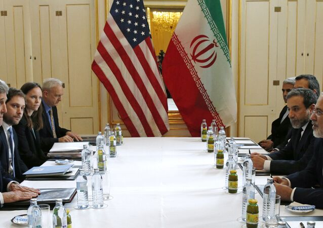 US Secretary of State John Kerry, left, meets with Iranian Foreign Minister Mohammad Javad Zarif, right, in Vienna, Austria, Saturday, Jan. 16, 2016, on what is expected to be implementation day, the day the International Atomic Energy Agency (IAEA) verifies that Iran has met all conditions under the nuclear deal.