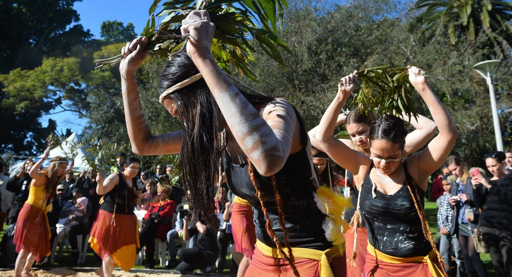 Indigenous Australian performers hold a smoking ceremony to open NAIDOC Week, a national program that celebrates the National Aborigines and Islanders Day Observance Committee in Sydney on July 6, 2015
