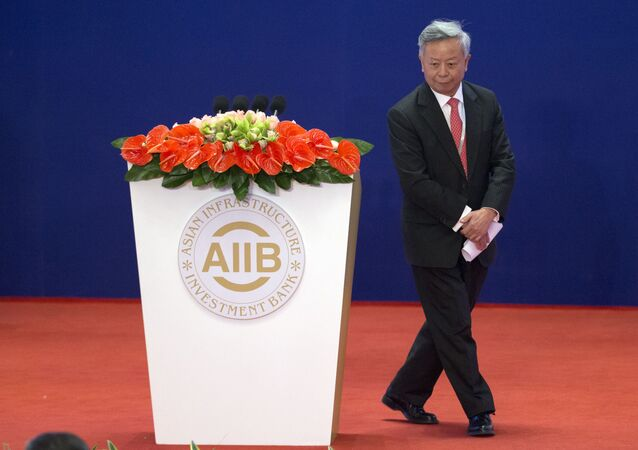 Jin Liqun, the first president of the Asian Infrastructure Investment Bank (AIIB), leaves the podium during the opening ceremony of the AIIB in Beijing Saturday, Jan. 16, 2016