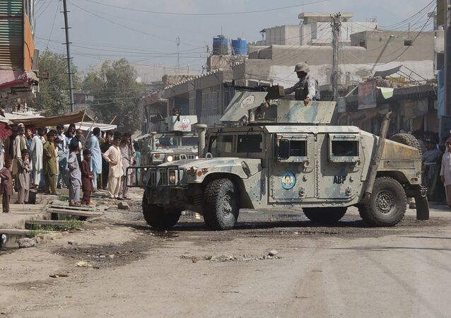 Afghan security forces inspect the site of a suicide attack in Jalalabad, east of Kabul, Afghanistan (File)