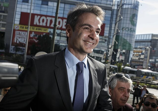 Newly elected leader of Greece's conservative New Democracy party Kyriakos Mitsotakis arrives at the party's headquarters, a day after winning the party elections, in Athens, Greece January 11, 2016