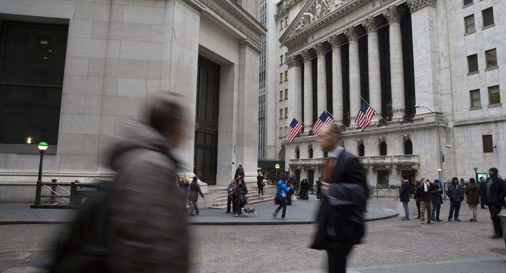 Pedestrians walk past the New York Stock Exchange, Friday, Jan. 15, 2016