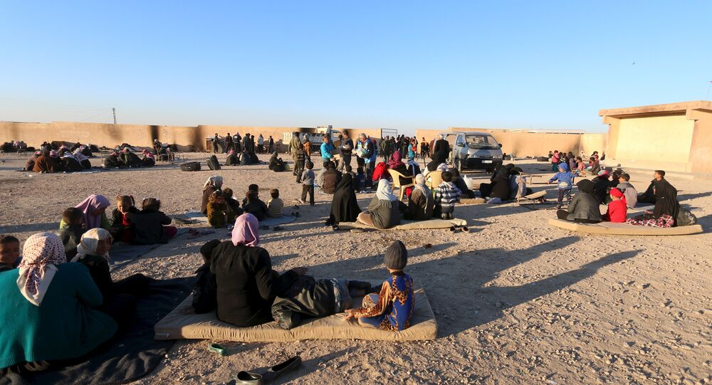 Displaced families, fleeing violence in Aleppo city and from Islamic State-controlled areas in Raqqa and Deir al-Zor, sit at a school in al-Mabroukeh village in the western countryside of Ras al-Ain, Syria December 28, 2015