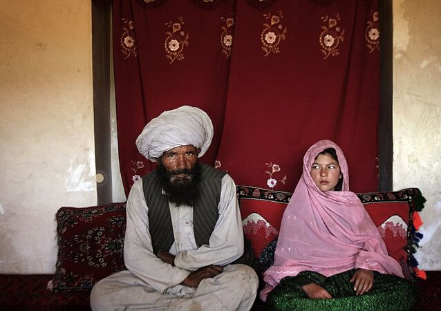 A young Pakistani woman on the day of her wedding to an older man