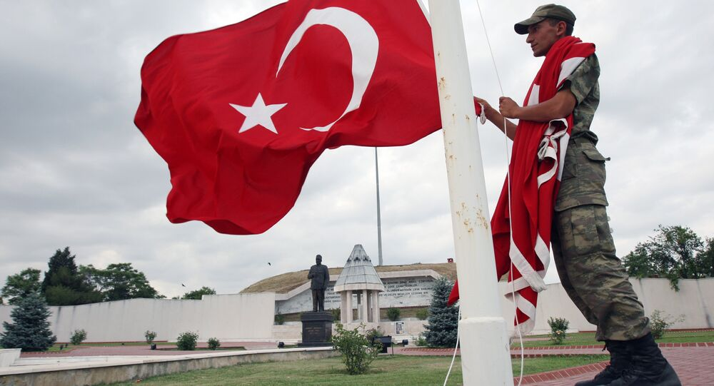 Turkish soldier handles a national flag at the monument of Sukru Pasa, a national hero who defended Edirne region during the Balkan War in 1913, in Edirne, western Turkey (File)