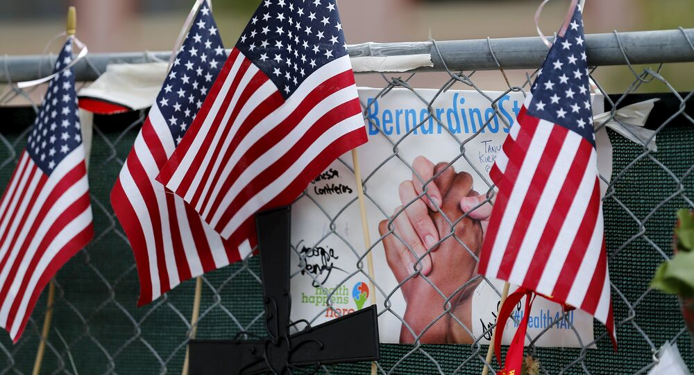 A memorial still remains outside as workers return to work for the first time at the Inland Regional Center (IRC) in San Bernardino, California, January 4, 2016.