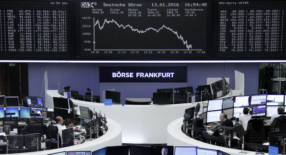 Traders work at their desks in front of the German share price index, DAX board, at the stock exchange in Frankfurt, Germany, January 13, 2016