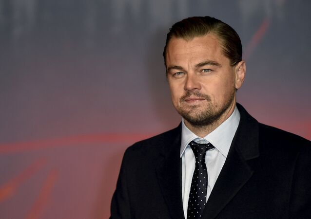 Actor Leonardo DiCaprio poses as he arrives for the British premiere of The Revenant, in London, Britain January 14, 2016