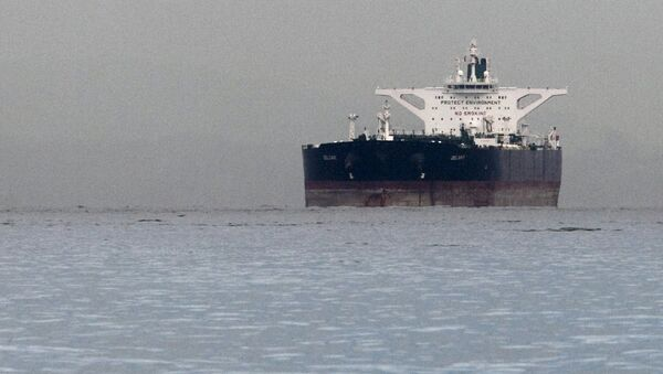 Malta-flagged Iranian crude oil supertanker Delvar is seen anchored off Singapore in this March 1, 2012. File photo - Sputnik International