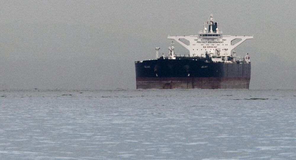 Malta-flagged Iranian crude oil supertanker Delvar is seen anchored off Singapore in this March 1, 2012 file photo
