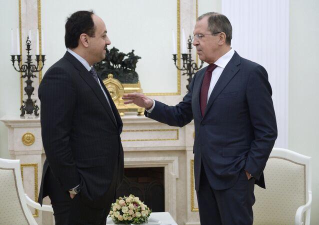 Qatari Foreign Minister Khalid Bin Mohamed al-Attiyah (left) and his Russian counterpart Sergei Lavrov talking before President Vladimir Putin's Kremlin meeting with Qatari Emir Tamim bin Hamad Al-Thani, January 18, 2016