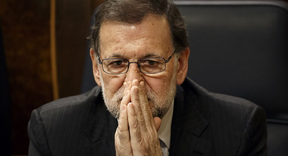 Spain's Acting Prime Minister Mariano Rajoy sits on his chair at the Spanish Parliament in Madrid, Wednesday, Jan. 13, 2016