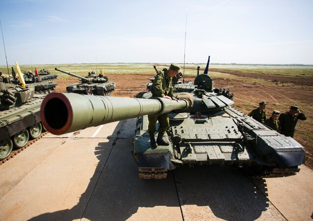 Tank crews of the Southern Military District preparing for the tank biathlon competition at the Prudboi range in the Volgograd Region