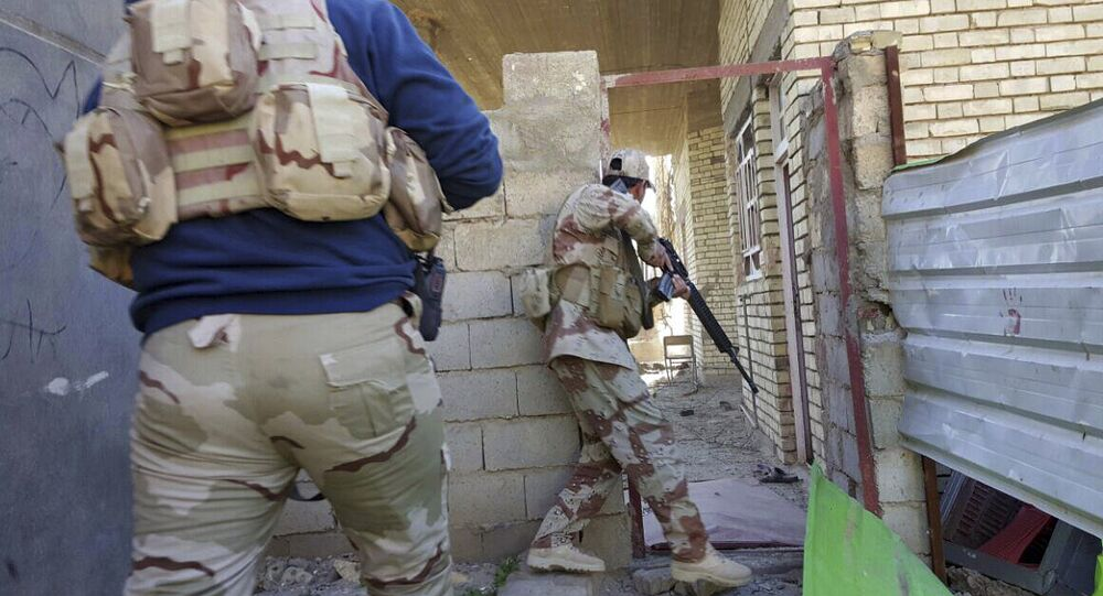 Iraqi security forces clear houses of Daesh militants in Ramadi, 70 miles (115 kilometers) west of Baghdad, Iraq, Sunday, Jan. 17, 2016