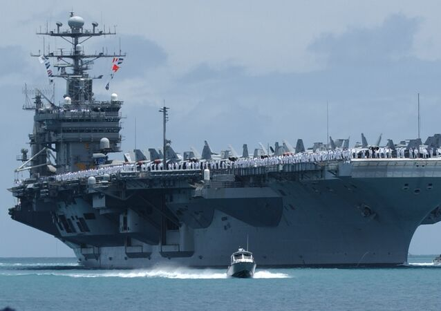 The USS John C. Stennis arrives in Pear Harbor, Hawaii, Tuesday, June29, 2004
