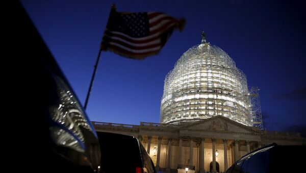 A U.S. flag on a vehicle flutters as the sun sets behind the U.S. Capitol dome in the hours before President Barack Obama delivers the State of the Union address to a joint session of Congress in Washington January 12, 2016 - Sputnik International
