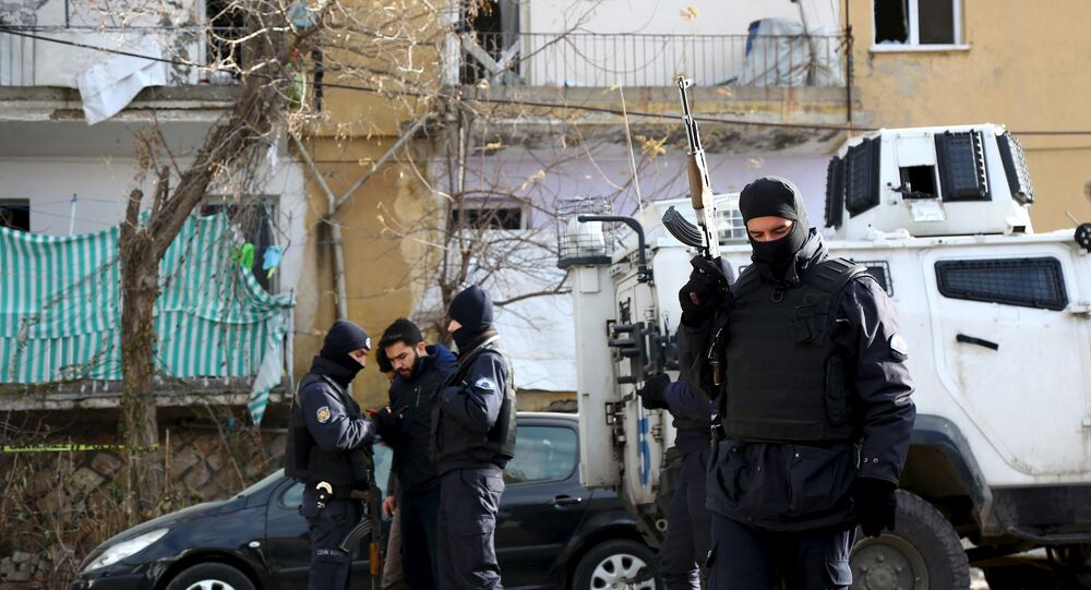 Turkish police stand guard near a police station, which was targeted by a truck bomb attack, in Cinar in the southeastern city of Diyarbakir, Turkey, January 14, 2016