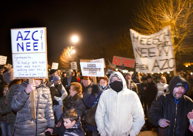 People gather to protest against the plans to open a refugee centre for 500 regufees in Heesch on January 18, 2016