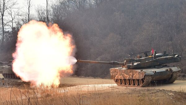 South Korean army's K-2 tank fires during a live-fire drill in Yangpyeong, 60 km east of Seoul, on February 11, 2015 - Sputnik International