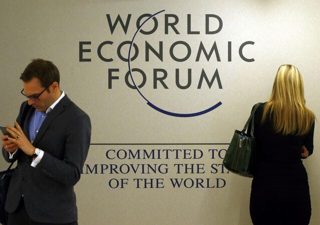 Attendees use their mobile device during the annual meeting of the World Economic Forum (WEF) in Davos, Switzerland January 20, 2016
