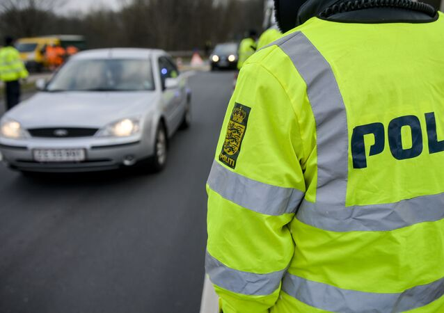 Danish Police officers check vehicles at the bordertown of Krusa, Denmark January 4, 2016.