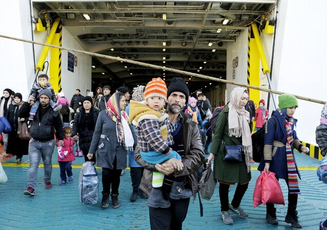 Refugees and migrants arrive aboard the passenger ferry Eleftherios Venizelos from the island of Lesbos at the port of Piraeus, near Athens, Greece, December 26, 2015.