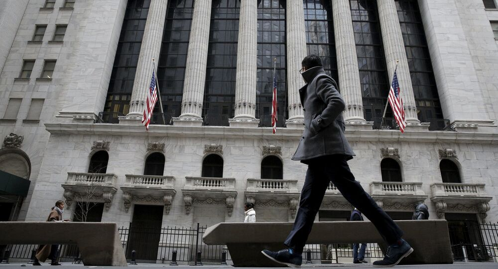 A man passes by the New York Stock Exchange in New York's financial district January 15, 2016