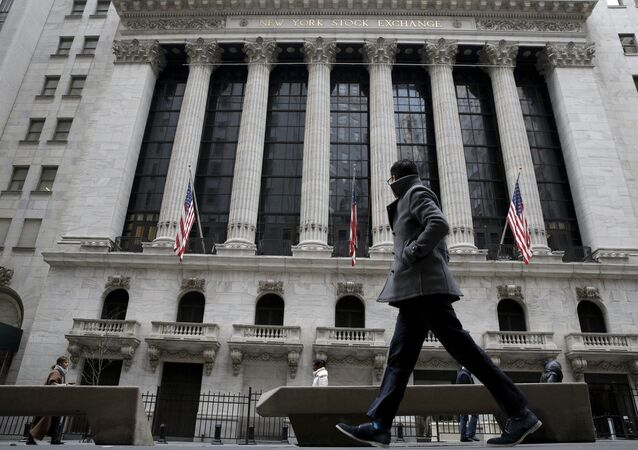 A man passes by the New York Stock Exchange in New York's financial district. File photo.