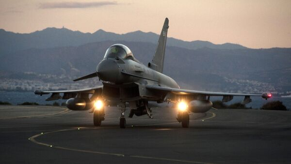 A British Royal Air Force Eurofighter Typhoon fighter jet is seen on the tarmac at the British airbase at Akrotiri, near Cyprus' second city of Limassol on December 3, 2015 - Sputnik International