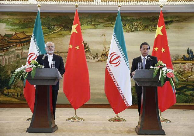 China's Foreign Minister Wang Yi (R) and Iranian Foreign Minister Javad Zarif (L) attend a press conference after a bilateral meeting in Beijing on September 15, 2015