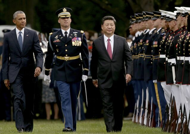 President Barack Obama and Chinese President Xi Jinping inspect the troops during an official state arrival ceremony for the Chinese president, Friday, Sept. 25, 2015, on the South Lawn of the White House in Washington.