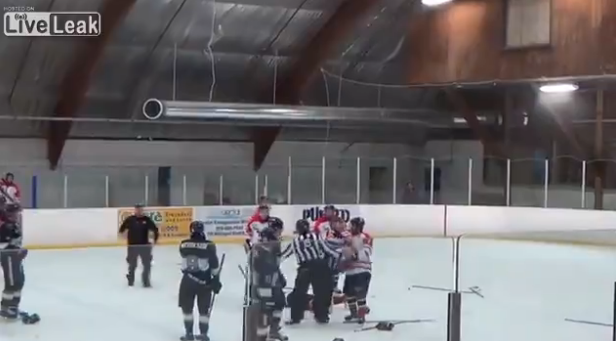 Hockey ref punches player then gets tackled by coach