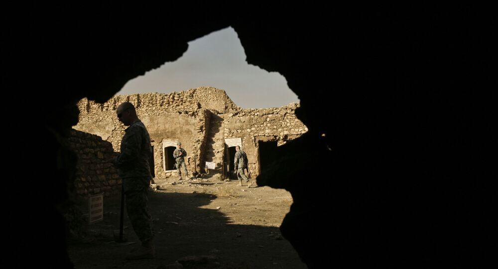 FILE - In this Nov. 7, 2008 photo, U.S. Army soldiers tour St. Elijah's Monastery on Forward Operating Base Marez in Mosul, Iraq.