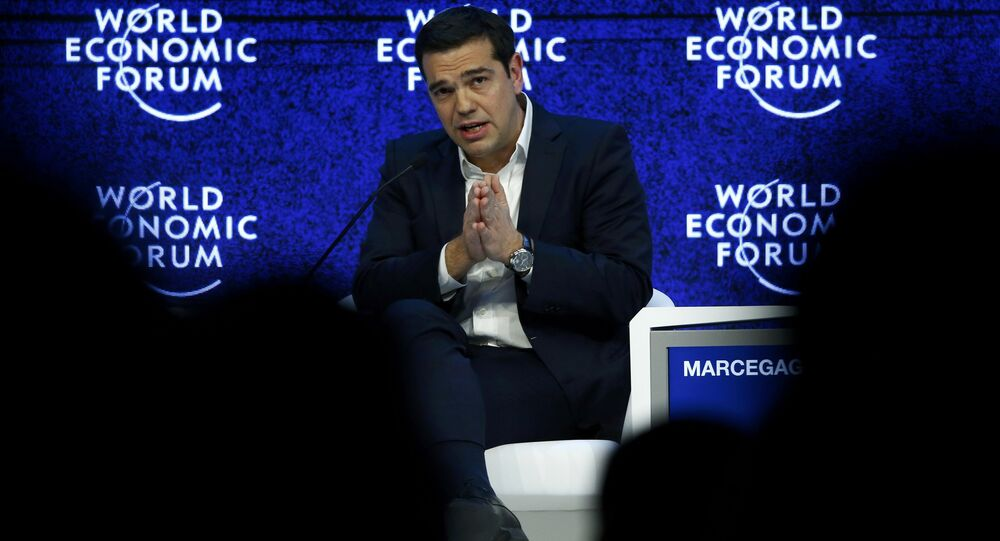 Greek Prime Minister Alexis Tsipras gestures during the session 'The Future of Europe' at the annual meeting of the World Economic Forum (WEF) in Davos, Switzerland January 21, 2016.