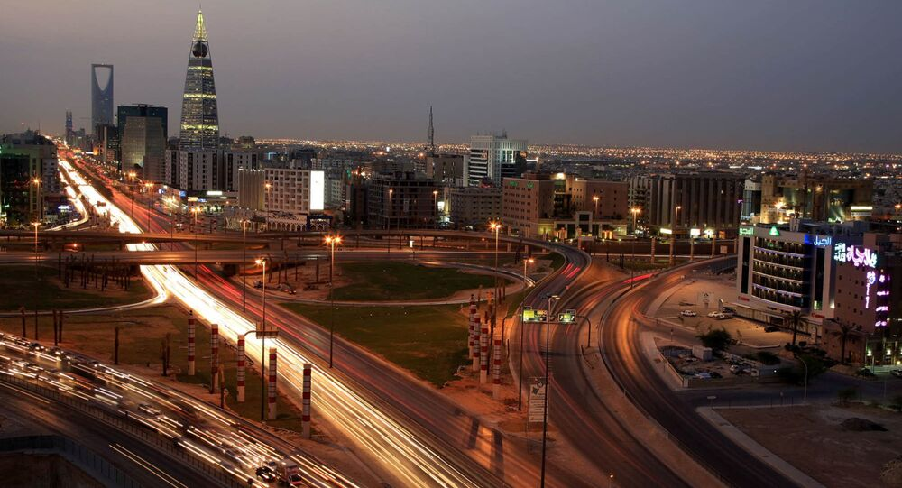 Saudi Arabian city view with the 'Kingdom Tower', background, and 'Al-Faislia Tower' in Riyadh, Saudi Arabia
