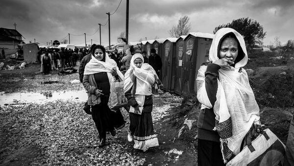 Refugees at the Calais 'Jungle' camp. - Sputnik International
