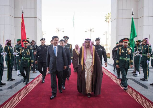 Saudi King Salman (centre R) and Chinese President Xi Jinping review the honour guard during a welcoming ceremony in Riyadh