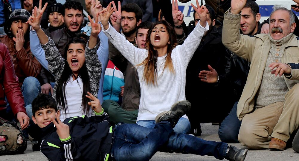 Kurdish demonstrators shout slogans during a protest against a curfew in Sur district and security operations in the region, in the southeastern city of Diyarbakir, Turkey January 17, 2016.